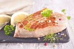 Grilled tuna steak. On board Stock Photos
