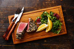 Grilled Tuna steak in sesame and lemon Stock Photography