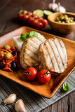 Grilled tuna steaks with rice and tomato sauce Stock Image