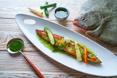 Grilled turbot over wild asparagus Stock Images
