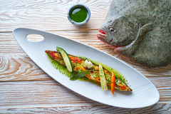 Grilled turbot over wild asparagus Stock Image