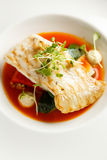 Grilled turbot, tabouli, sweet pepper sauce and summer vegetables. White dish Stock Photography