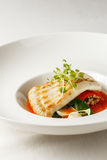 Grilled turbot, tabouli, sweet pepper sauce and summer vegetables. White dish Royalty Free Stock Photography