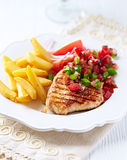 Grilled Turkey Breast Fillet with Salsa and French Fries Royalty Free Stock Photography