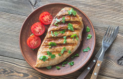 Grilled turkey breast with parsley and tomatoes Stock Photo