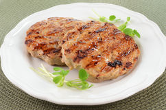 Grilled turkey burgers. Grilled extra lean turkey burgers brushed with sweet chili sauce Stock Photos