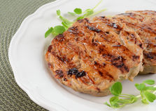Grilled turkey burgers. With sweet chili sauce brushed on Royalty Free Stock Photography