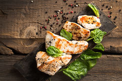 Grilled turkey fillet with appetizing roasted crust garnish spin Royalty Free Stock Photo