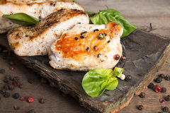 Grilled turkey fillet with appetizing roasted crust garnish spin Royalty Free Stock Images