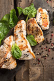 Grilled turkey fillet with appetizing roasted crust garnish spin. Grilled turkey fillet with bright appetizing roasted crust garnish spinach and black sesame Royalty Free Stock Images