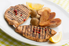 Grilled turkey fillet ,fried potatoes Stock Image