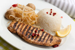 Grilled turkey fillet ,rice,soy sprouts Royalty Free Stock Photography