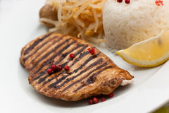 Grilled turkey fillet ,rice,soy sprouts Stock Photo