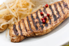 Grilled turkey fillet ,rice,soy sprouts Royalty Free Stock Images