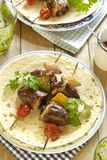 Grilled turkey heart kebab with vegetables Stock Photo