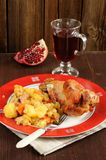 Grilled turkey with mashed potatoes, pomegranate and glass of wi. Ne on wood background Royalty Free Stock Photos