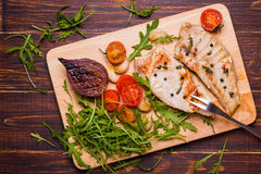 Grilled turkey steak on a cutting board Stock Images