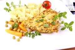 Grilled turkey steak with fusilli peas, carrots, tomato and oregano Royalty Free Stock Photos