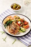 Grilled turkey steak with salad. Concept for healthy eating and nutrition. Royalty Free Stock Photo