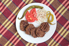 Grilled Turkish meatball ( Kofte ) on white plate.  Royalty Free Stock Photo