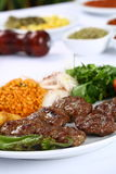 Grilled Turkish meatball. On white dinner table Stock Photography