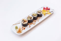 Grilled Unagi Japanese Freshwater Eel Sushi Maki Roll Served with Wasabi and Prickled Ginger Stock Photo