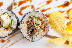 Grilled Unagi Japanese Freshwater Eel Sushi Maki Roll Served with Wasabi and Prickled Ginger Royalty Free Stock Images