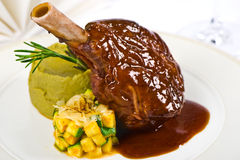 Grilled veal. Shank with vegetables and sauce royalty free stock photos