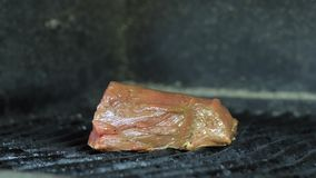 Grilled veal close up, a piece of red marinated meat is fried for a delicious dish. stock footage