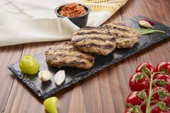 Free Grilled Veal Minced Meat With Spices On Black Stone And Wooden Background Royalty Free Stock Images - 117637909