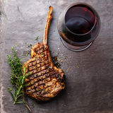 Grilled Veal rib Steak on bone and red wine Stock Image