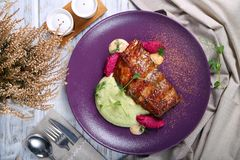 Grilled veal ribs with side dish of potatoes royalty free stock photos
