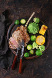 Grilled veal steak with vegetables Royalty Free Stock Images