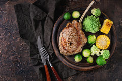 Grilled veal steak with vegetables Royalty Free Stock Photo