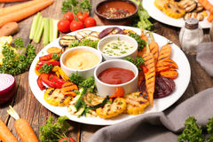 Grilled vegetable and dips Stock Images