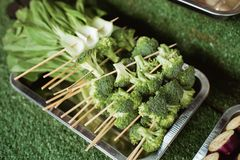 Grilled vegetable on a dish pan. Variety of other vegetables in the background at a street food cafe royalty free stock photo
