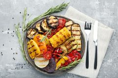 Grilled vegetable. On brown cutting board with fork and knife Royalty Free Stock Photo