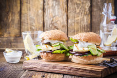 Grilled vegetable and haloumi burger with romaine lettuce. On wooden table, Greek style Stock Photo