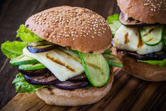 Grilled vegetable and haloumi burger with romaine lettuce. On wooden table, Greek style Royalty Free Stock Image