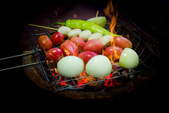 Grilled vegetable and meat ball with charcoal stove Stock Image