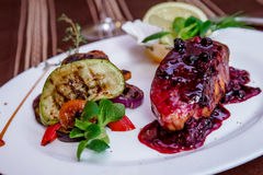 Grilled Vegetable with Salmon in berries souce. Plating Royalty Free Stock Photography