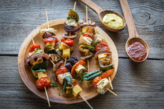 Grilled vegetable skewers on the plate Stock Images