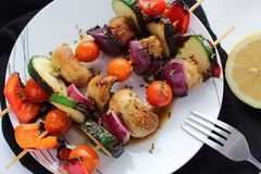 Grilled vegetable on skewers with tomato, pepper, mushrooms,zucchini and onion. Vegan lunch. royalty free stock photo