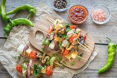 Grilled vegetable skewers on the wooden board Stock Photography