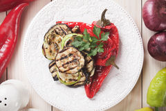 Grilled vegetable. Zucchini, aubergine and red bell pepper grilled on a barbecue Stock Photo