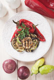 Grilled vegetable. Zucchini, aubergine and red bell pepper grilled on a barbecue Stock Images