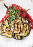 Grilled vegetable. Zucchini, aubergine and red bell pepper grilled on a barbecue Stock Photography