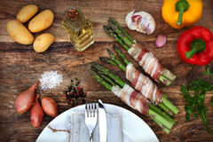 Grilled vegetables and asparagus in bacon Royalty Free Stock Photography