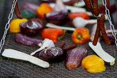 Grilled vegetables and hunting sausages cooking on street. With copy space Stock Images