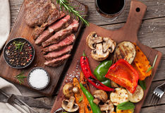 Grilled vegetables and beef steak on cutting board Royalty Free Stock Photo